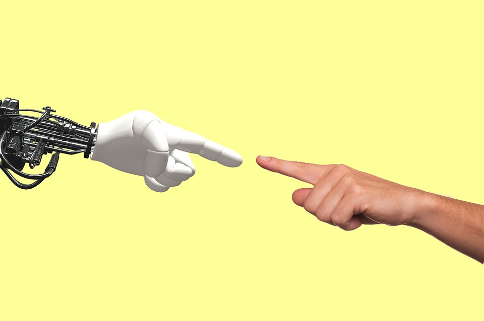 robot arm and human arm touching