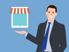 Businessman holding online shop icon