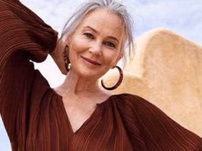Radiant woman with grey hair in brown dress - Defiant