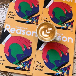 Cover of magaizne Weapons of Reason with coffee cup on top